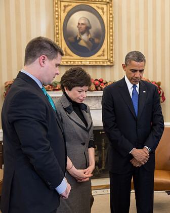 President Obama and others observing a minute of silence